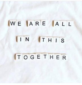 """typewriter letters spelling out """"we are all in this together"""""""