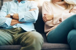 couple sitting on a couch discussing divorce